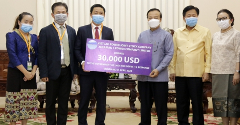 VIETNAMESE ENTERPRISES JOIN HAND WITH LAO PDR TO FIGHT AGAINST COVID-19